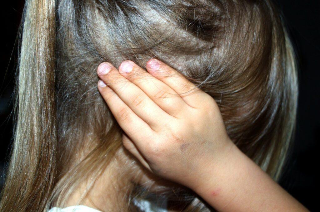 girl-covering-her-ear