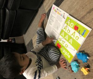 toddler-writing-in-abc-book