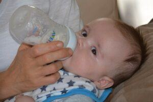 Baby-drinking-milk-from-a-Philip-Avent-bottle