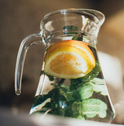 8 Beverages to keep Breastfeeding Moms Hydrated other than Water-water infused with lemon slices and herbs