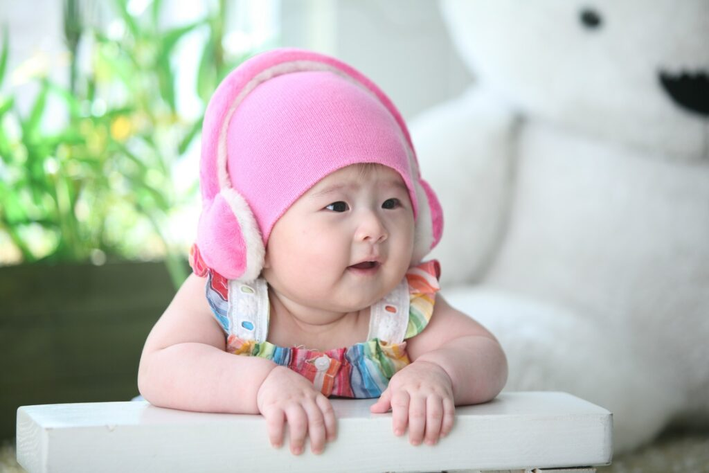 best free podcast for kids-baby with pink headphone