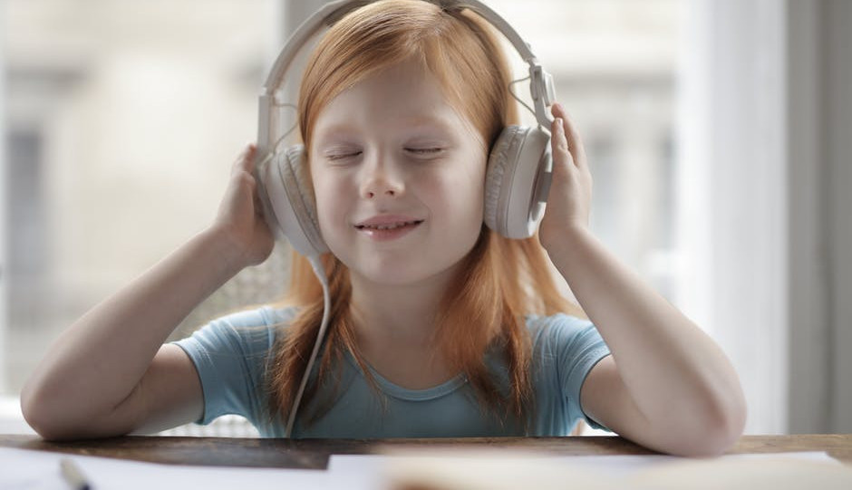 best free podcasts for kids-girl with gray headphone