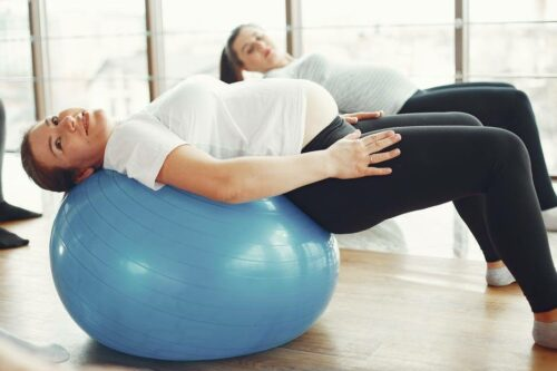 What Classes Should You Take Before Having a Baby-pregnancy women on a exercise ball