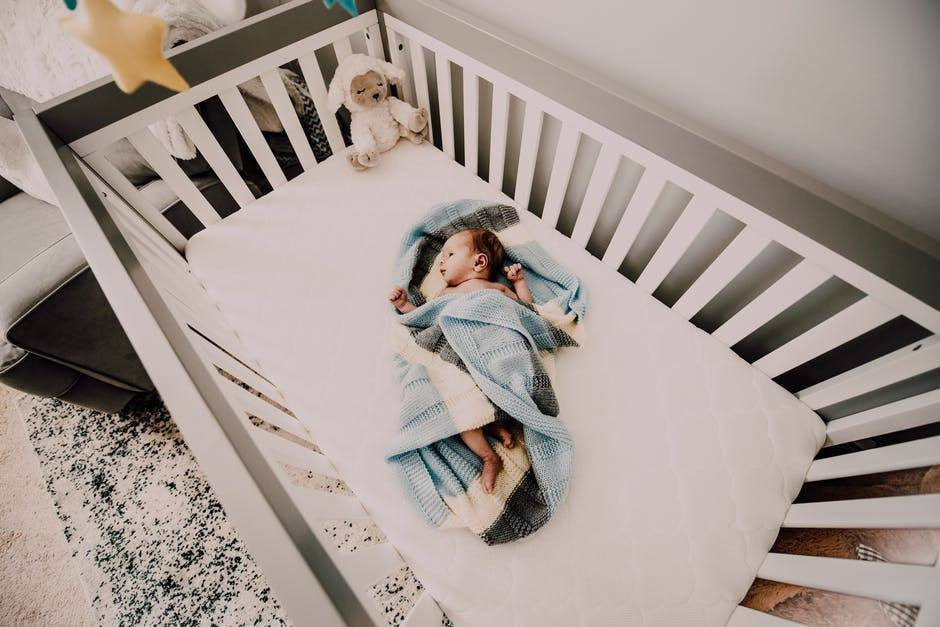 21 Days to Peace and Quite Review -infant sleeping in crib