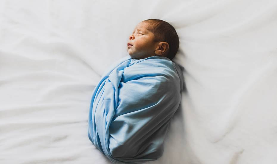 First Night Home from Hospital and Baby Won't Sleep-baby swaddled in blue blanket