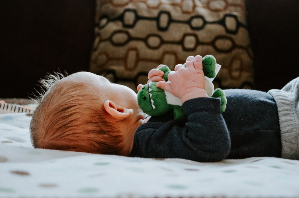 7 Easy Tips to Wean 2 Years Old Off a Bottle at Night- toddler sleeping with lovey
