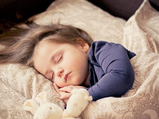 7 Easy Tips to Wean 2 Years Old Off a Bottle at Night-toddler sleeping with lovey
