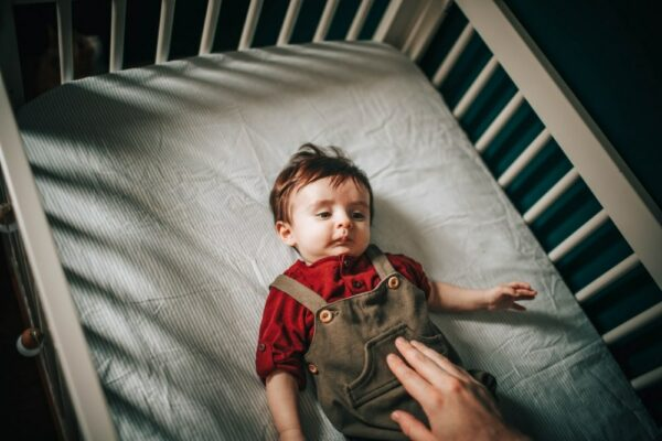 Baby Moves Around in the Crib While Sleeping - baby awake in the crib