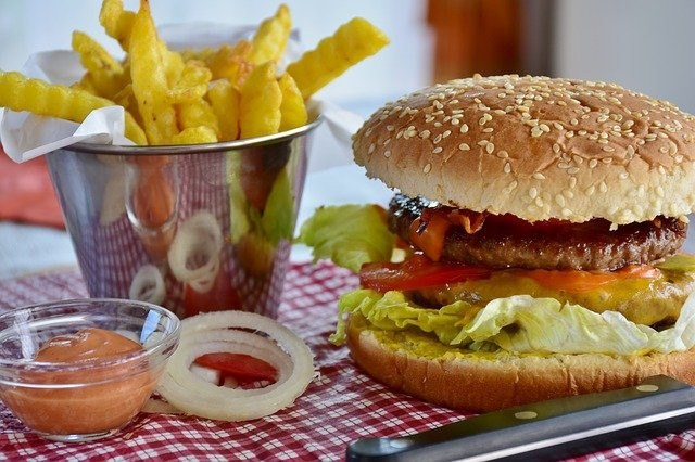 Help! Pregnant and can't Stop Eating Junk Food- burger, fries, onion ring on the table
