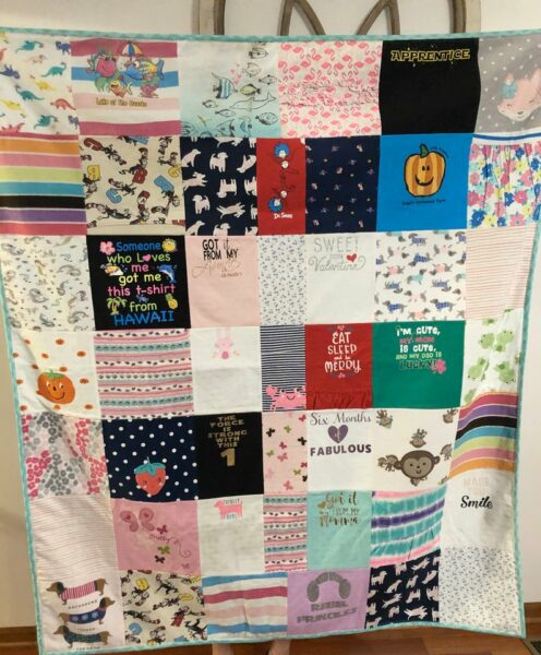 19 Creative Ways to Repurpose Old Baby Clothes into Keepsakes - memory quilt made from baby clothes