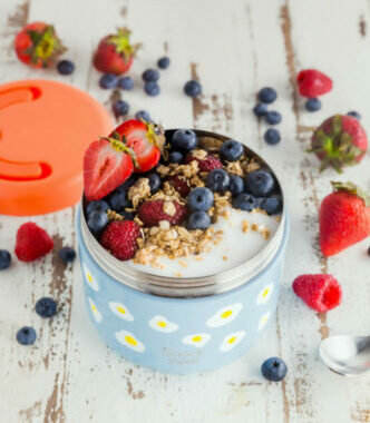 21 Healthy Snacks to Pack in Hospital Bag for Labor-Oatmeal in a container topped with strawberry, blueberry