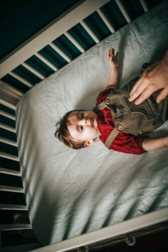 Naturepedic Crib Mattress Review-Baby laying on the top of crib mattress