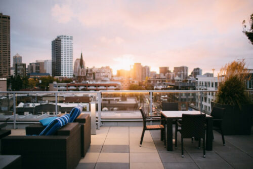 sitting on rooftop patio with sunset view