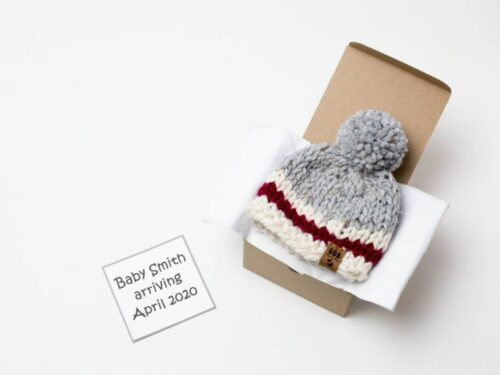 box with baby hats for note a white note