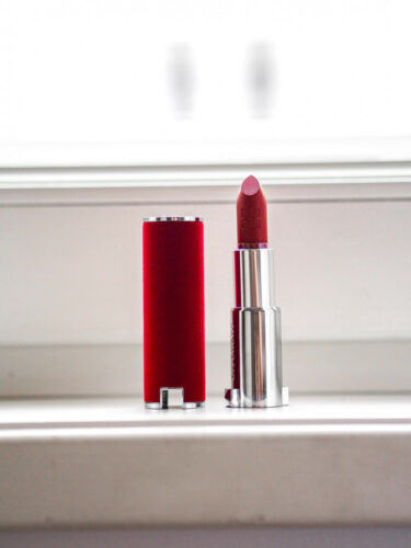 new red opened lipstick with lid